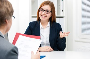 Young woman discussing during a job interview at office