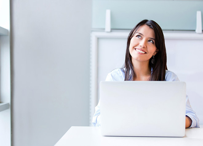 51826-sitting-at-a-computer-company-employee